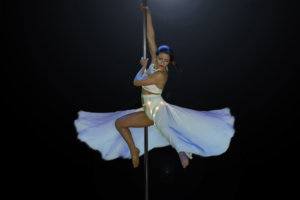 girl white dress pole dancing stage performance
